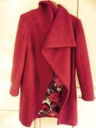 Ela's coat